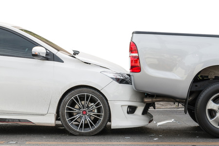 involving: Car accident involving two cars on the road Stock Photo