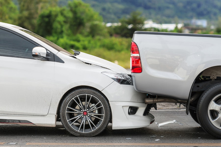 Car accident involving two cars on the road 스톡 콘텐츠