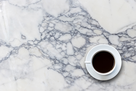 Close up white coffee cup on stone table background top view
