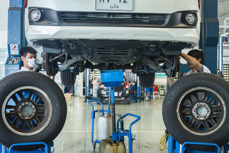 scheduled replacement: PHUKET, THAILAND - APRIL 22 : Car technician repairing car in workshop service station in Phuket on April 22, 2016. The official dealer of Toyota, who is the top market share for commercial car.