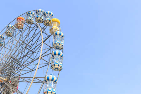 ferriswheel: Brightly colored Ferris wheel against the blue sky