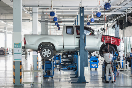scheduled replacement: PHUKET, THAILAND - APRIL 19 : Car technician repairing car in workshop service station in Phuket on March 19, 2016. The official dealer of Toyota, who is the top market share for commercial car.