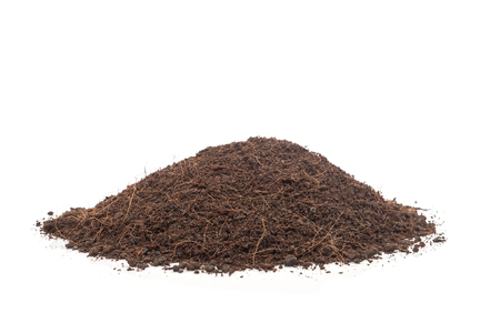 earth handful: Close up pile of soil isolated on white background Stock Photo