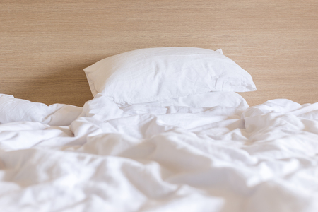 case sheet: Close up white bedding sheets and pillow, Messy bed concept Stock Photo