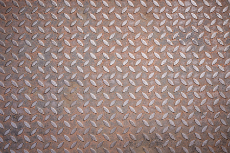 Texture of diamond plate rusty metal for background