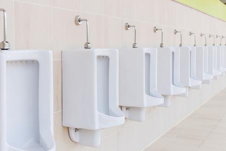 latrine: New row of outdoor urinals Men public toilet