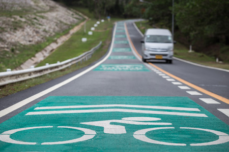 lanes: Separated of green bicycle lanes on the asphalt road