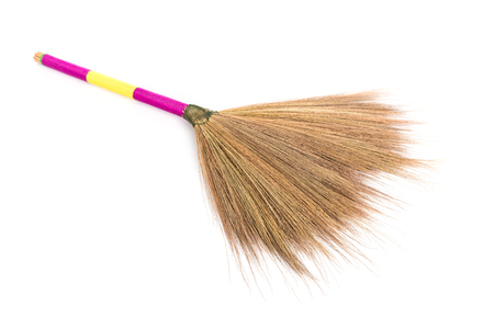 besom: Close up new broom grass isolated on white background