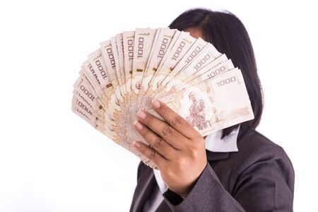 recieving: Woman holding Thai money hide her face isolated on white background