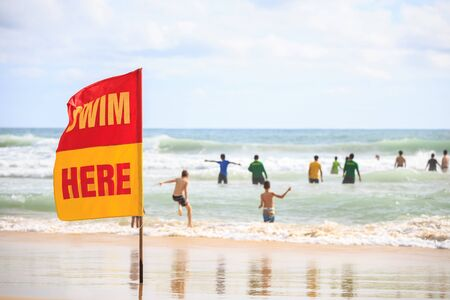 SWIM HERE red flag on the beach in Phuket, Thailand