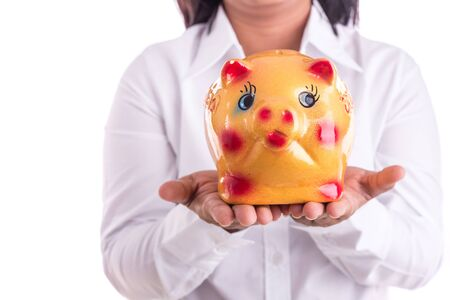 recieving: Woman holding yellow piggy bank isolated on white background