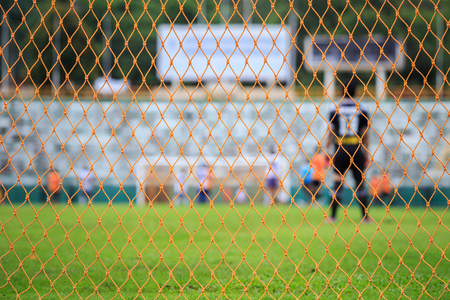 winning pitch: Orange soccer net and blur of player in stadium Stock Photo