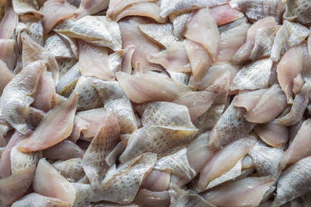 Top view stack of Sliced raw, Fresh fish after filleting. Food background
