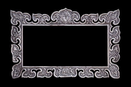 saved: The traditional Thai style handmade silver metal carving isolated on black background. Saved with clipping path