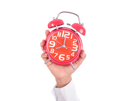 Woman holding red alarm clock isolated on white background Stock Photo