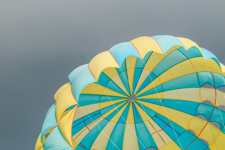 Parasailing, beach umbrella on sky background in Phuket, Thailand
