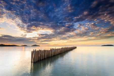 Bamboo wall in the sea and beautiful sunrise at Saphan Hin, Phuket, Thailand