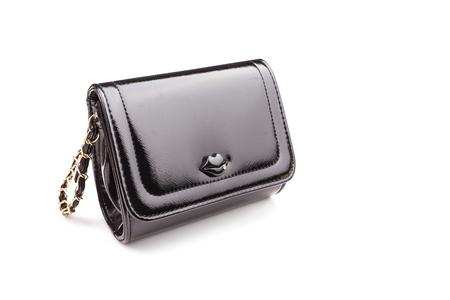 personal shopper: New black ladies handbag isolated on white background