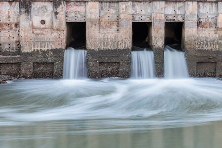 piped: Water flowing from drain to the river