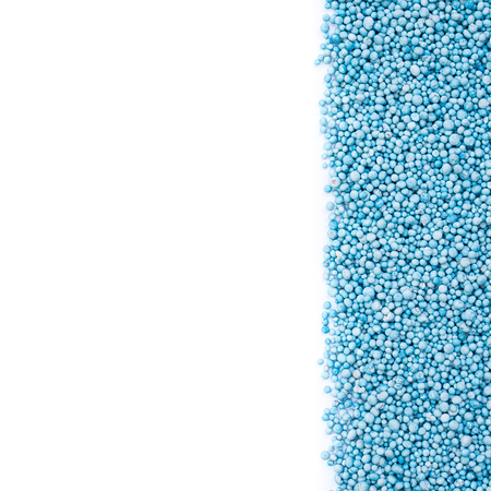 urea: Top view of pattern blue urea fertilizer isolated on white background