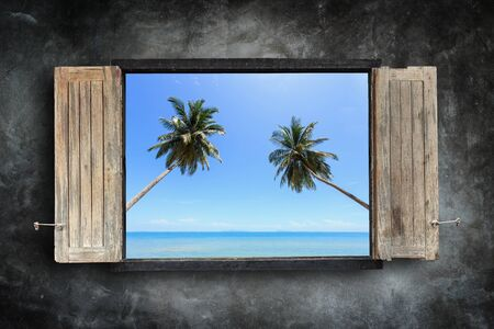 windows frame: Old wooden windows frame on stone wall and view of tropical sea