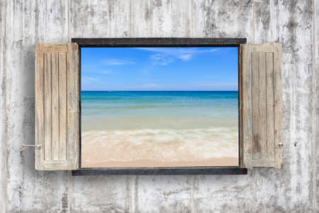 windows frame: Old wooden windows frame on cement wall and view of tropical sea