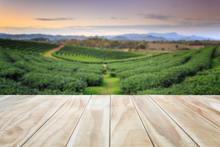 Empty top of wooden table or counter and view of landscape background. For product display