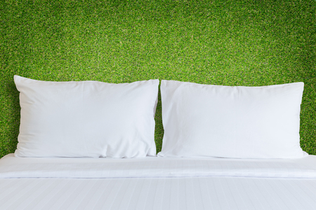 bedding: Close up white bedding sheets and pillow in hotel room Stock Photo
