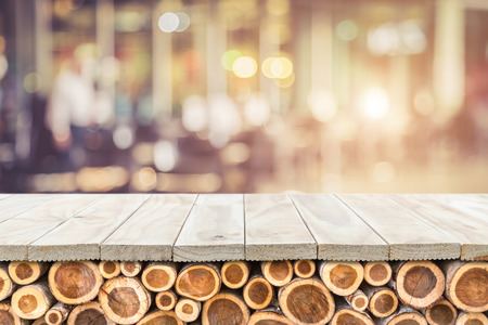 Empty top of wooden table or counter with pile wood log  and sunny abstract blurred bokeh background. Can use for product display Stock Photo