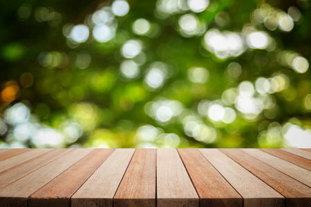 Empty top wooden table and sunny abstract blurred bokeh background. Can use for product display