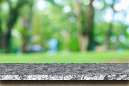 Empty top of natural stone table and abstract blurred with bokeh background, Can use for product display Stock Photo