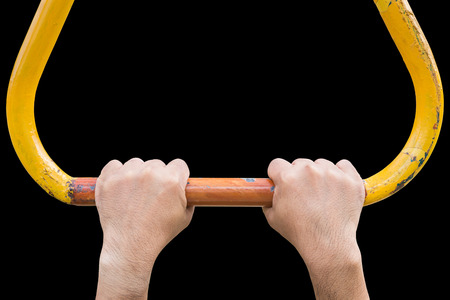 Close up hand hanging on steel bar for trapeze. Outdoor exercise equipment at public park. Isolated on white background. Saved with clipping path