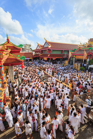 rite: PHUKET, THAILAND - SEPTEMBER 30 : An unidentified people a perform a ceremony set the sacred wood poles is the symbol of the beginning Phuket Vegetarian Festival in Phuket on September 30, 2016.