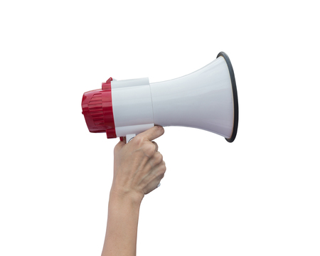 mega phone: Right hand holding white megaphone isolated on white background. Saved with clipping path