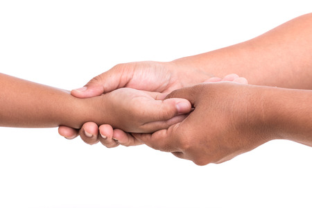 Close up womans hand holding childrens hand isolated on white background. Hand pain concept.