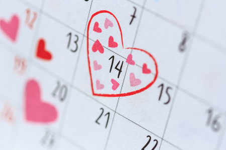 Date 14 in calendar with heart symbol. Valentine day and love concept