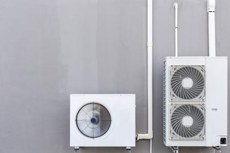 Outdoor air conditioning compressor installed the wall Foto de archivo