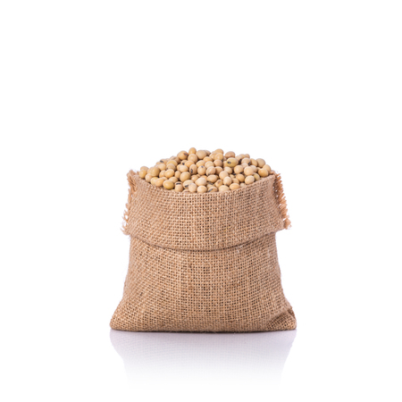 Close up soybean in small sack. Studio shot isolated on white background