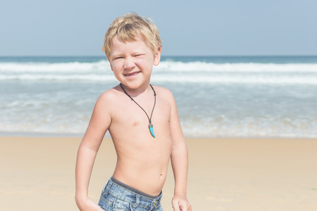 Caucasian boy from europe with happy and relax time on the tropical beach at Karon, Phuket province southern of Thailand