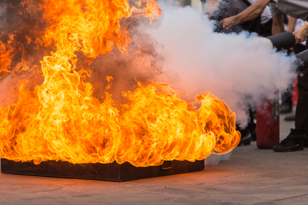 Thai people in the conflagration preventive extinguisher training program, Safety concept. Focus on fire tray