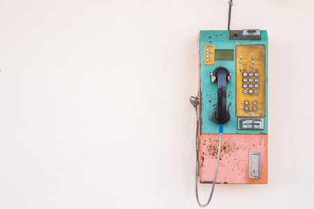 Old public phone using coin or card setting on the wall. With empty space for text