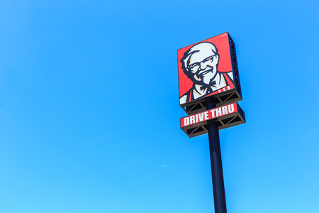 PHUKET, THAILAND - JULY 28, 2017 : KFC logo on blue sky. KFC is a fast food restaurant chain that specializes in fried chicken. Editorial