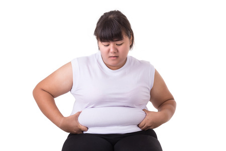 Fat Asian woman wear white t-shirt worried about her body size  isolated on white background Banque d'images