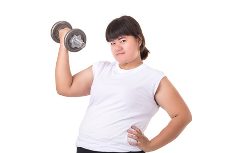 Fat Asian woman wear white t-shirt and holding dumbbell isolated on white background. Exercise and healthycare concept
