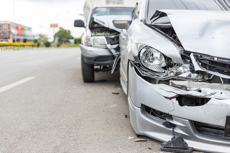 Modern car accident involving two cars on the road in Thailand Foto de archivo
