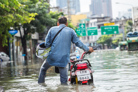 BANGKOK, THAILAND - OCTOBER 14 : Flooding in Din Daeng District after the heaviest rains in 20 years in Bangkok on October 14, 2017.
