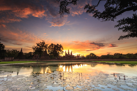 Sukhothai Historical Park at Sunset time, Sukhothai province, Located in a beautiful setting of lawns, lakes and trees in north-central of Thailand
