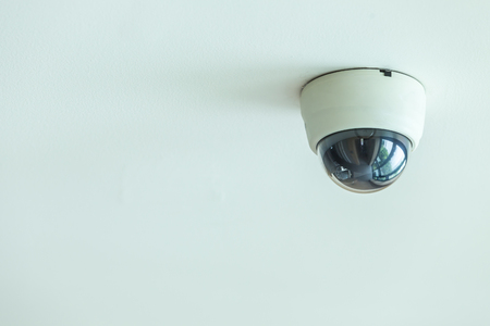 Close up CCTV system installed on the ceiling in the hotel corridor Banque d'images