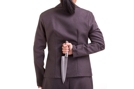 Business criminal concept : Businesswoman holding the new silver knife isolated on white background