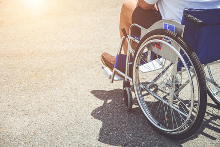 Close up disabled people sitting on the wheelchair in the park Stock Photo